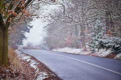 Asphalt road leading to winter Ore mountains with dream stylization Royalty Free Stock Photos