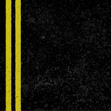 Asphalt with road lines. Grunge asphalt background with two yellow lines Stock Image