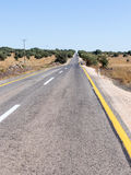Asphalt road of local significance passing through the Golan Heights,  near the border with Syria in Israel Stock Photos