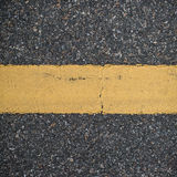 Asphalt road with marking lines. Close-up background texture Royalty Free Stock Photos
