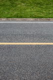 Asphalt road with marking lines. Close-up background texture wit Royalty Free Stock Photography
