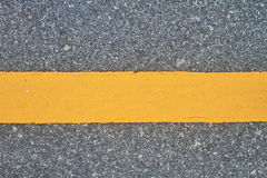 Asphalt road with marking lines and tire tracks Royalty Free Stock Photography