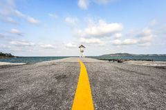 Asphalt road with marking lines to the sea. Cloud sky Stock Photo
