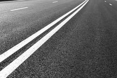Asphalt road with marking lines white stripes Royalty Free Stock Image