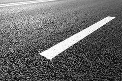 Asphalt road with marking lines white stripes Stock Images