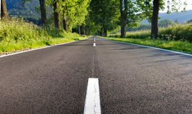 Asphalt road in the middle of the rular countryside Stock Photo