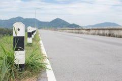Asphalt road. Asphalt road with mountain background Royalty Free Stock Image