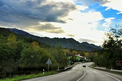 Asphalt road and mountain landscape Stock Photography