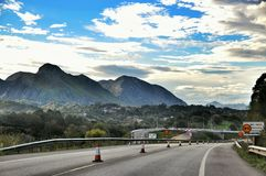 Asphalt road and mountain landscape Royalty Free Stock Images