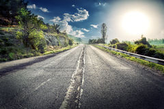 Asphalt road in a mountainous area Royalty Free Stock Photos