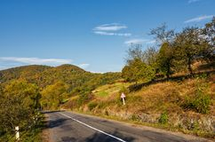 Asphalt road in mountainous countryside Royalty Free Stock Photography