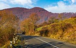 Asphalt road mountainous countryside. Beautiful autumn morning scenery Stock Image