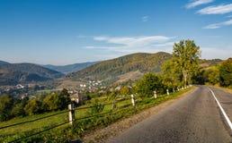 Asphalt road in mountainous countryside Stock Photo