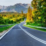 Asphalt road in mountains. The beauty of the world Royalty Free Stock Image