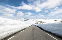 Asphalt road through the mountains with a lot of snow, summer Norway. National Tourist Route Aurlandsfjellet. Royalty Free Stock Photo