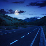 Asphalt road in mountains at night Royalty Free Stock Photo