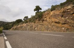 Asphalt road in the mountains of Spain on a sunny day Royalty Free Stock Image