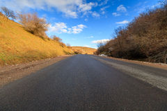 Asphalt road, mountains of the Western Tien-Shan, Uzbekistan Royalty Free Stock Photo