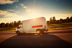 Asphalt road with a moving van Stock Image