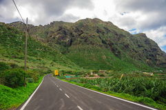 Asphalt road near the mountains in Tenerife, Canary Islands Stock Photo