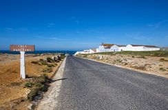 Asphalt road near Peniche Remédios cross, Portugal. royalty free stock image