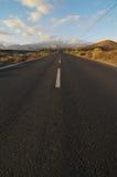 Asphalt Road nel deserto Immagine Stock