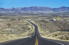 Asphalt road in Nevada. Asphalt road and expanse of Nevada Royalty Free Stock Photography