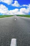 Asphalt road over blue sky Stock Image
