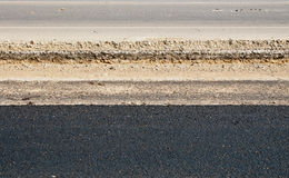Asphalt road rebuilding closeup Royalty Free Stock Photos