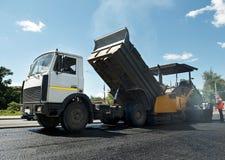 Asphalt road repairing works Royalty Free Stock Photo