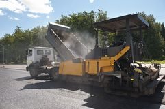 Asphalt road repairing works Stock Photo
