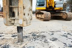Asphalt Road repairing works with hydrohammer Royalty Free Stock Photography