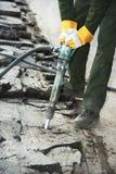 Asphalt Road repairing works with jackhammer royalty free stock photos