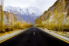 Asphalt Road Between Rock Mountains royalty free stock photo