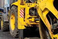 Asphalt road roller at pavement works. Asphalt road roller at work Royalty Free Stock Image