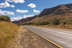 Asphalt Road Running Through Dry Orange Winter Mountain Landsca Royalty Free Stock Image