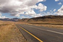 Asphalt Road Running Through Dry Orange Winter Mountain Landsca Royalty Free Stock Photography