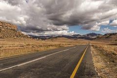 Asphalt Road Running Through Dry Orange Winter Mountain Landsca Stock Photo