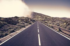 Asphalt road running at the foot of the volcano Royalty Free Stock Photography