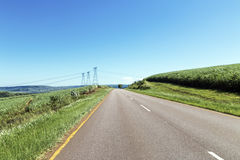Asphalt Road Through Rural Landscape Stock Photo