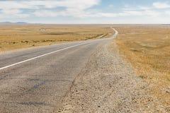 Asphalt road Sayshand-Choir in Mongolia. Beautiful landscape, Gobi Desert stock photos