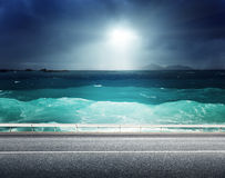 Asphalt road and sea Royalty Free Stock Photo