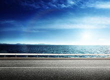 Asphalt road and sea Royalty Free Stock Photos