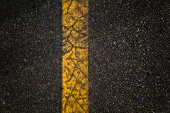 Asphalt road with separation yellow lines. An Asphalt road with separation yellow lines Royalty Free Stock Photography