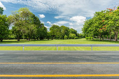 Asphalt road. Side view of asphalt road with park in city royalty free stock photo