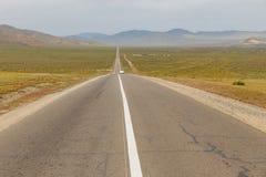 Asphalt road Sukhe Bator - Darkhan in Mongolia. Beautiful landscape, Mongolia royalty free stock photos