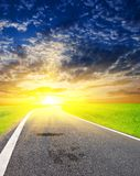 Asphalt road at the sunset Royalty Free Stock Photo