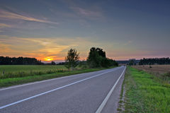Asphalt road in sunset light Royalty Free Stock Images