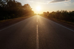Asphalt road in sunset Royalty Free Stock Photography