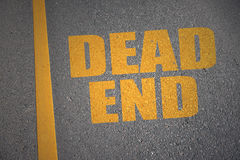 Asphalt road with text dead end near yellow line. Concept royalty free stock photography